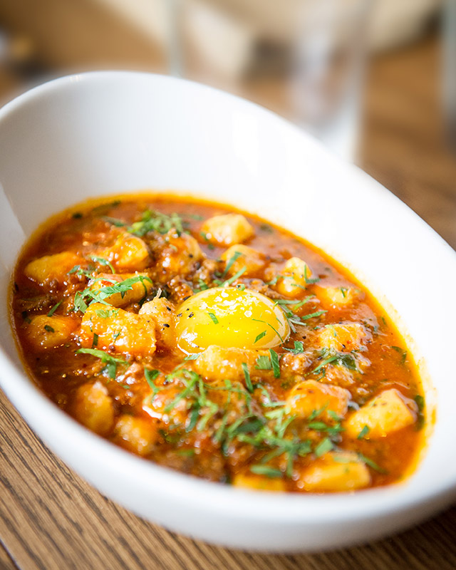 lesser-traveled-new-orleans-compere-lapin-goat-bolognese-with-potato-gnocchi-and-egg-photo-credit-elsa-hahne