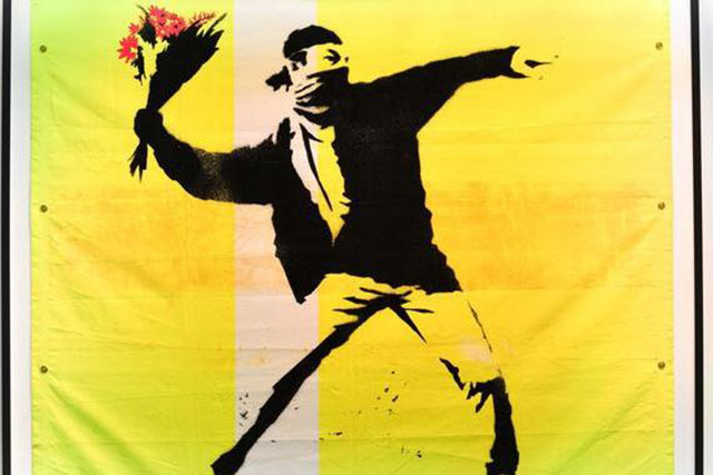 wywd-art-the-art-of-banksy-banksy_s-flower-thrower-is-one-of-the-artists_-most-famous-artworks.-photo_tristan-fewings